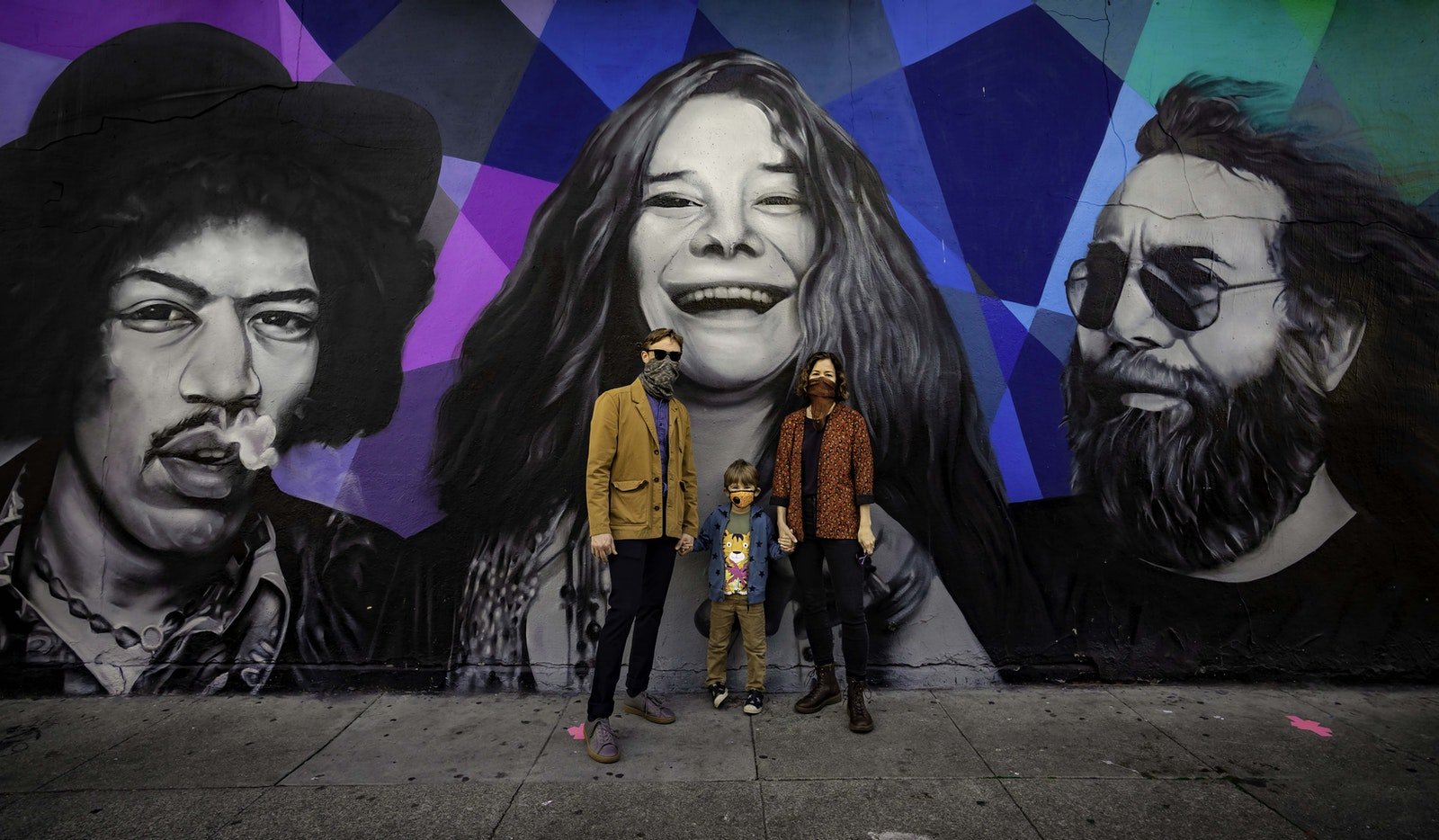 Jessica Valeri, Jonathan Vinocourt and son in front of Mural